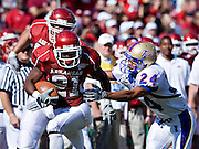 FAYETTEVILLE, AR - NOVEMBER 1:   Michael Smith #21 of the Arkansas Razorbacks tries to avoid the tackle of  Charles Davis #24 of the Tulsa Golden Hurricanes at Donald W. Reynolds Stadium on November 1, 2008 in Fayetteville, Arkansas.  The Razorbacks defeated the Golden Hurricanes 30 to 23.  (Photo by Wesley Hitt/Getty Images) *** Local Caption *** Michael SmithUniversity of Arkansas Razorback Men's and Women's athletes action photos during the 2008-2009 season in Fayetteville, Arkansas....©Wesley Hitt.All Rights Reserved.501-258-0920.