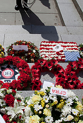 © Licensed to London News Pictures. 11/09/2011. London, UK. The London Fire Brigade and the Firefighters' Memorial Trust marked the tenth anniversary of the September 11th terror attacks with a wreath-laying ceremony at the Firefighters' National Memorial in Peter's Hill near St. Paul's Cathedral. This event also marked the 20th anniversary of the Firefighters' Memorial Trust. Photo credit: Bettina Strenske/LNP