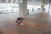 man cleaning floor by hand Japan