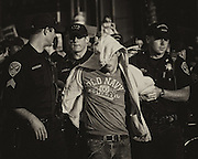 Protestors are detained after staging a civil disobedience outside the San Francisco Westfield Shopping Centre.