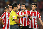 Athletic de Bilbao's Carlos Gurpegui, Koikili Lertxundi, Andoni Iraola and the referee Carlos Velasco Carballo have words during the Supercup of Spain.August 23 2009.