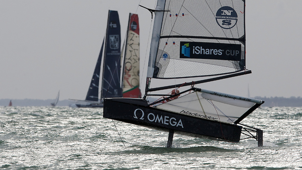 ENGLAND, Cowes, iShares Cup, 2nd August, Geoff Carveth buzz's the iShares fleet on a Foiling Moth.