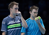 Tennis - 2017 Nitto ATP Finals at The O2 - Day One<br /> <br /> Mens Doubles: Group Eltingh/Haarhus: Henri Kontinen (Finland) & John Peers (Australia) Vs Ryan Harrison (United States) & Michael Venus (Australia)<br /> <br /> John Peers (Australia) and Henri Kontinen (Finland) pass information secretly<br /> <br /> COLORSPORT/DANIEL BEARHAM