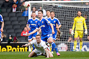 MK Dons midfielder Carl Baker draws a foul during the Sky Bet Championship match between Milton Keynes Dons and Brentford at stadium:mk, Milton Keynes, England on 23 April 2016. Photo by Dennis Goodwin.