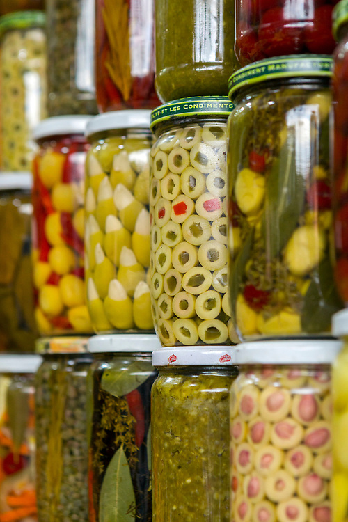 Preserved lemons, olives and pickles for sale at the food market behind Djemma el Fna main square Marrakech, 2018–05-27.