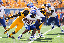 Oct 6, 2018; Morgantown, WV, USA; Kansas Jayhawks running back Pooka Williams Jr. (1) runs the ball during the fourth quarter against the West Virginia Mountaineers at Mountaineer Field at Milan Puskar Stadium. Mandatory Credit: Ben Queen-USA TODAY Sports