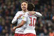 Nottingham Forest midfielder Matty Cash (14) celebrates with Nottingham Forest forward Joao Carvalho (10) 0-2 during the EFL Sky Bet Championship match between Aston Villa and Nottingham Forest at Villa Park, Birmingham, England on 28 November 2018.