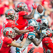 On the last play of the game Tampa Bay Buccaneers cornerback De'Vante Harris (22) reaches for the ball with teammates free safety Jordan Whitehead (31) and wide receiver Mike Evans (13) against Carolina Panthers tight end Ian Thomas (80), middle bottom, and wide receiver Curtis Samuel (10) loses his helmet at the end of the Carolina Panthers at Tampa Bay Buccaneers NFL football game on Sunday, Dec. 2, 2018, in Tampa, Fla. (Willie J. Allen, Jr./AP)