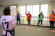 "Corrine Bailey, or Coco, a sophmore studying dance leads teams in a ""grocery store game""The Dance-A-Thon was creatively full of team games to keep the dance spirits motivated and active during the twelve hour dance party, and also to give contestants a break from dancing. However, contestants were not allowed to sit down without loosing points from their team."