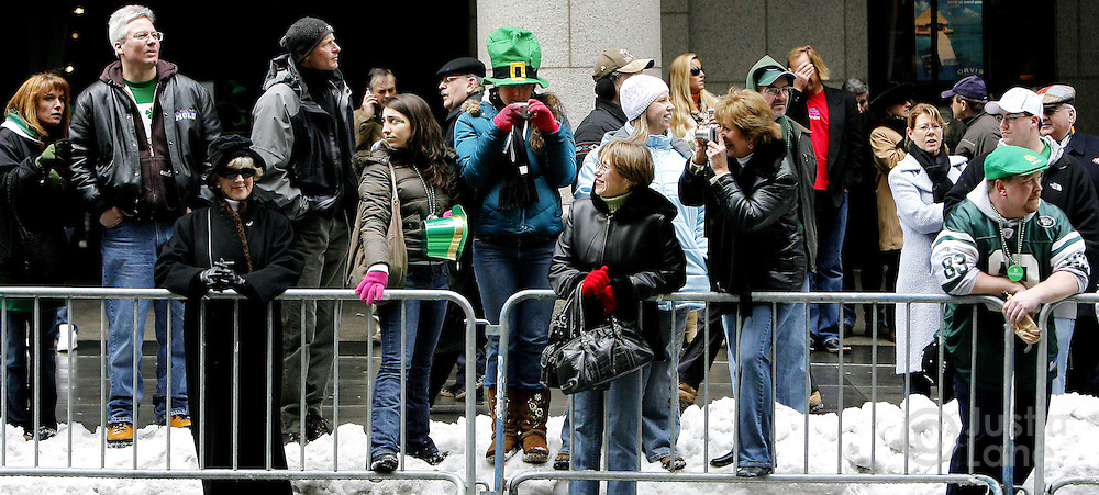 Spectators stand along 5th Avenue while watching the 246th annual St. Patrick's Day parade in New York, New York on Saturday 17 March 2007. The annual event is the largest St. Patrick's Day Parade in the world.