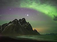 Northern lights over Stokksnes beach. Mount Vestrahorn in background. Southeast Iceland.