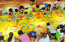 July 19, 2017 - Qinhuangdao, Qinhuangdao, China - Qinhuangdao,CHINA-July 19 2017: (EDITORIAL USE ONLY. CHINA OUT) Kids and teachers draw a giant painting of the city they live at a kindergarten in Qinhuangdao, north China's Hebei Province, July 19th, 2017. (Credit Image: © SIPA Asia via ZUMA Wire)