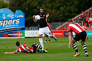 Michael Bostwick (16) of Lincoln City is tackled by Lloyd James (4) of Exeter City during the EFL Sky Bet League 2 match between Exeter City and Lincoln City at St James' Park, Exeter, England on 19 August 2017. Photo by Graham Hunt.