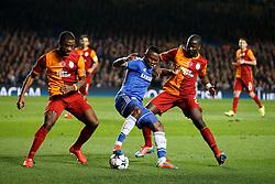 Chelsea Forward Samuel Eto'o (CMR) is challenged by Galatasaray Midfielder Aurelien Chedjou (CMR) - Photo mandatory by-line: Rogan Thomson/JMP - 18/03/2014 - SPORT - FOOTBALL - Stamford Bridge, London - Chelsea v Galatasaray - UEFA Champions League Round of 16 Second leg.