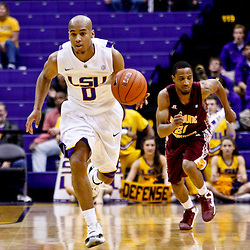 Jan 5, 2013; Baton Rouge, LA, USA; LSU Tigers guard Charles Carmouche (0) takes the ball on a fast break down court past Bethune-Cookman Wildcats guard Kevin Dukes (21) during the second half of a game at the Pete Maravich Assembly Center. LSU defeated Bethune-Cookman 79-63. Mandatory Credit: Derick E. Hingle-USA TODAY Sports