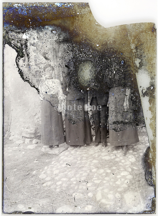 severely eroding glass plate with adult people standing full length