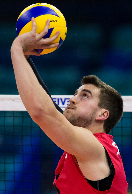 Tyler Sanders of Canada sets the ball versus Portugal at a World League Volleyball match at the Sasktel Centre in Saskatoon, Saskatchewan Canada on June 26, 2016.