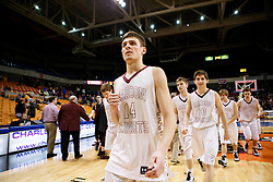 Wheeling Central guard Chase Harler (14) walks off after scoring 28 points and leading his team in the Championship game.