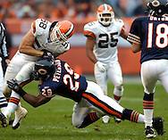 MORNING JOURNAL/DAVID RICHARD.Cleveland linebacker Ben Taylor, left, is cut down by Adrian Peterson while trying to get to quarterback Kyle Orton yesterday in the second half. Watching in the secondary is the Browns' Chris Crocker.