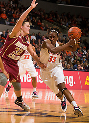 Virginia center Aisha Mohammed (33) challenges Boston Coll. forward/center Stefanie Murphy (32) in the lane.  The #21 ranked Virginia Cavaliers defeated the Boston College Eagles 90-70 at the John Paul Jones Arena in Charlottesville, VA on February 22, 2009.