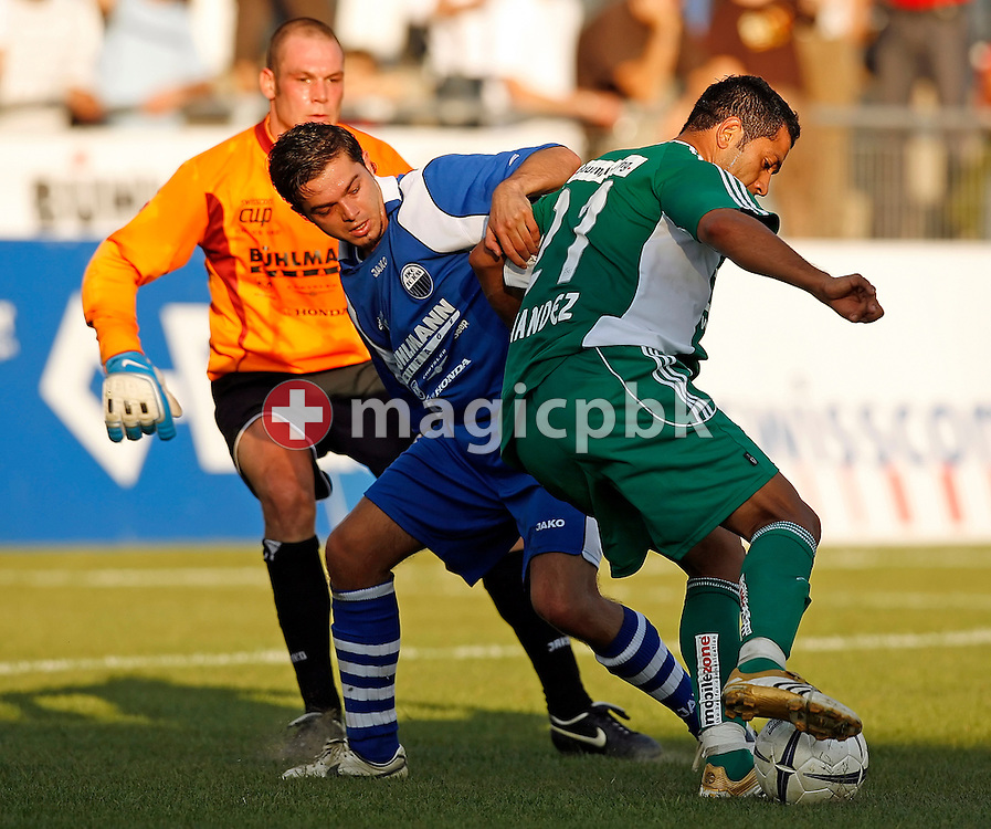 FCSG's player Adrian Fernandez (front) prepares the third goal for his team while FC Toess's Armend Kastrati (C) and keeper Bruno Meili (back) try to interrupt during the Swiss soccer cup game between FC Toess and the FC St. Gallen at the Schuetzenwiese stadium in Winterthur, Switzerland, Saturday, September 15, 2007. FC St. Gallen wins the game against FC Toess by eight to nil. (Photo by Patrick B. Kraemer / MAGICPBK)