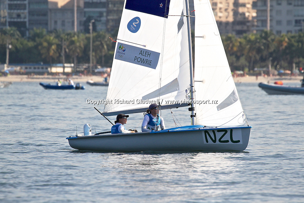 Jo Aleh and Polly Powrie wait for the breeze ahead of their Medal Race.  <br /> Copyright photo: Richard Gladwell / www.photosport.nz