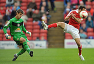 Josh Scowen of Barnsley is beaten to the ball by Ben Garrett of Crewe Alexandra during the Sky Bet League 1 match at Oakwell, Barnsley<br /> Picture by Graham Crowther/Focus Images Ltd +44 7763 140036<br /> 10/10/2015