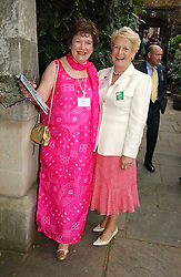Left to right, MRS KEITH SIMPSON and LADY GRIFFITHS at the annual Macmillan Cancer Support House of Lords vs the House of Commons Tug of War held in Victoria Tower Gardens on 20th June 2006.<br />