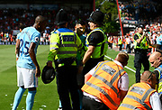 Sergio Aguero (10) of Manchester City getting involved with the stewards and police who have apprehended a Manchester City fan who invaded the pitch after Raheem Sterling (7) of Manchester City scored the winner during the Premier League match between Bournemouth and Manchester City at the Vitality Stadium, Bournemouth, England on 26 August 2017. Photo by Graham Hunt.