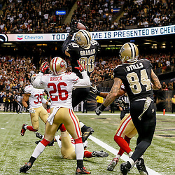 Nov 9, 2014; New Orleans, LA, USA; New Orleans Saints tight end Jimmy Graham (80) catches a ball in the endzone past San Francisco 49ers strong safety Antoine Bethea (41) and cornerback Tramaine Brock (26) but is flagged for offensive pass interference negating a touchdown on the final play of the fourth quarter of a game at Mercedes-Benz Superdome. The 49ers defeated the Saints 27-24 in overtime. Mandatory Credit: Derick E. Hingle-USA TODAY Sports