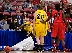 March 20, 2010; Stanford, CA, USA; Iowa Hawkeyes guard Kachine Alexander (center) crashes into the scorers table during the second half against the Rutgers Scarlet Knights in the first round of the 2010 NCAA womens basketball tournament at Maples Pavilion.  Iowa defeated Rutgers 70-63.