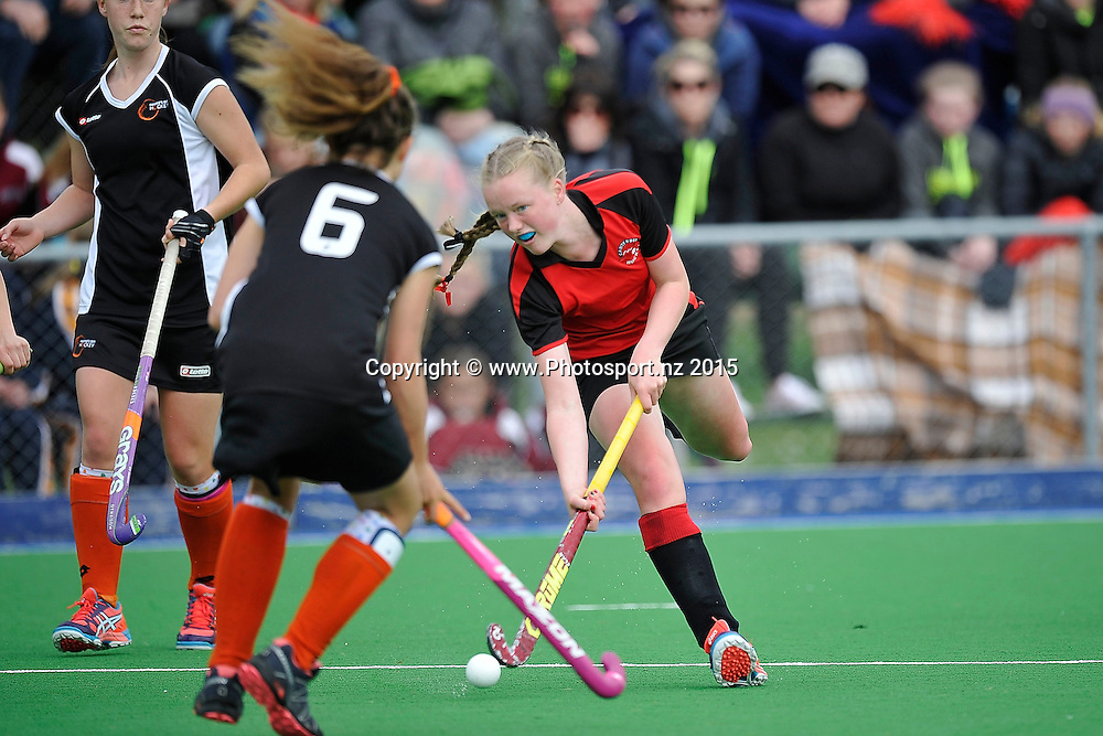 Francesca Williamson (R captain of Canterbury makes a pass under pressure by Ruby Roberts of Hawkes Bay during the Canterbury vs Hawkes Bay Collier Trophy U13 Girls Hockey Final at the Manawatu Hockey Stadium in Palmerston North on Saturday the 10 October 2015. Copyright photo by Marty Melville / www.Photosport.nz
