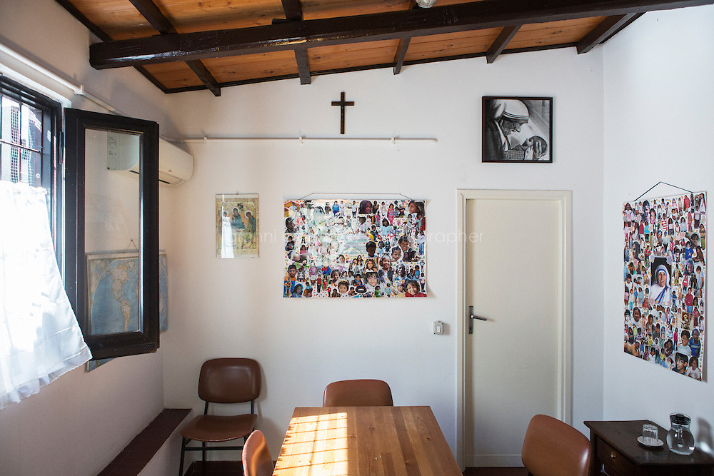 ROME, ITALY - 26 AUGUST 2016: The waiting room with pictures of Mother Teresa and children adopted by the Missionaries of Charity, the religious congregation founded by Mother Teresa in 1950, is seen here at the Mother House in Rome, Italy, on August 26th 2016.<br /> <br /> Mother Teresa, also known as Blessed Teresa of Calcutta, was an Albanian Roman Catholic nun and missionary. She founded the Missionaries of Charity, a Roman Catholic religious congregation, whose members must adhere to the vows of chastity, poverty, and obedience, as well as the vow to give wholehearted free service to the poorest of the poor. Shortly after she died in 1997, Pope John Paul II waived the usual five-year waiting period and allowed the opening of the process to declare her sainthood. She was beatified in 2003. A second miracle was credited to her intercession by Pope Francis, in December 2015, paving the way for her to be recognised as a saint by the Roman Catholic Church. Her canonisation is scheduled for September 4th 2016, a day before the 19th anniversary of her death.