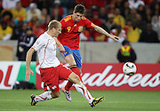 Stephane GRICHTING (L) challenges Fernando TORRES (R) during the 2010 FIFA World Cup South Africa Group H match between Spain and Switzerland at Durban Stadium on June 16, 2010 in Durban, South Africa.
