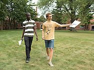 Reggie Sackey-Addo (from left), 17, of Accra, Ghana and Karl Sadkowski, 18, of Cedar Falls, Iowa talk as they walk across campus together at Grinnell College in Grinnell, Iowa on Saturday, August 25, 2012.