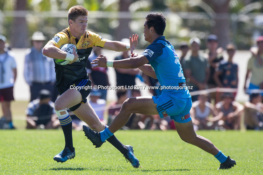 Jordie Barrett from the Hurricanes fends off Blues player Tamati Tua during the preseason Super Rugby match played between the Blues and the Hurricanes at Alexandra Park, Auckland on 4th February 2017. <br /> Credit; Peter Meecham/ www.photosport.nz