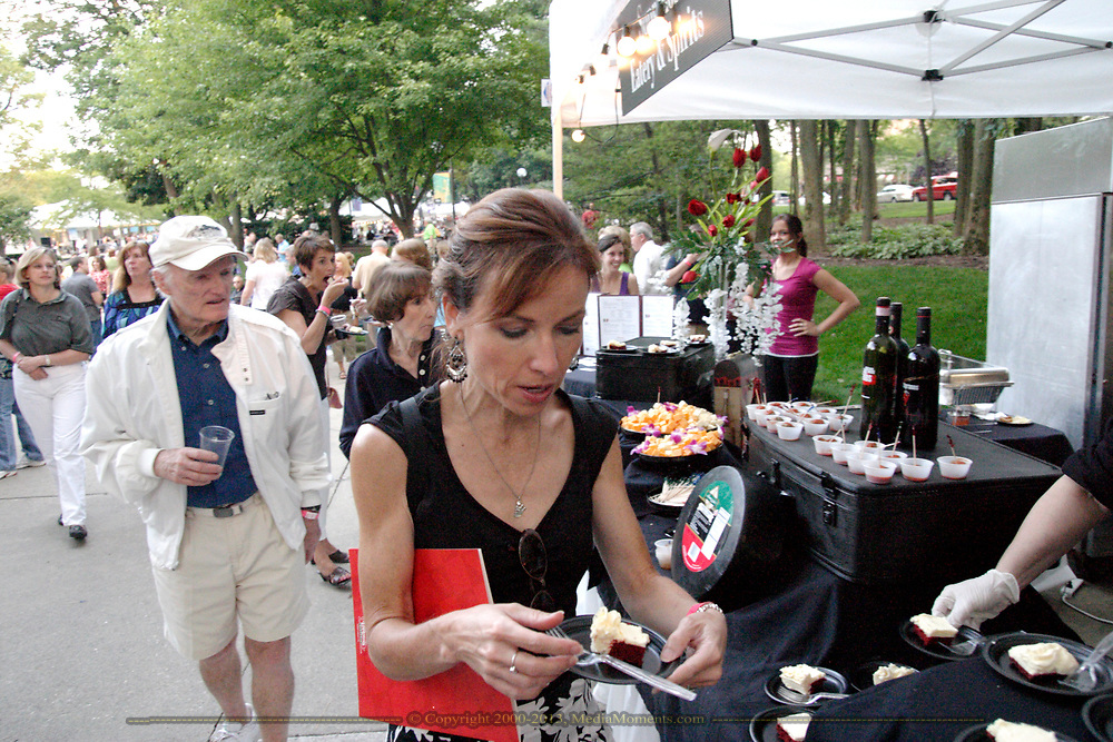 WDTN's Pam Elliot gets ready to sample the fare from Soprano's Eatery & Sprits during the 21st annual The Taste in the Lincoln Park Commons area at the Fraze Pavilion, Thursday, September 3, 2009.