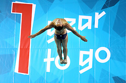 Client: LOCOG. Tom Daley dives at The Aquatic Centre to mark one year to go to the London 2012 Olympics. Photo: David Poultney
