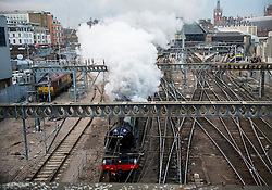 © Licensed to London News Pictures. 25/02/2016. London, UK. The Flying Scotsman locomotive train leaving Kings Cross station on it's inaugural run up the East Coast Mainline to York following a £4 million refurbishment. Photo credit: Ben Cawthra/LNP