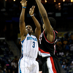 March 30, 2011; New Orleans, LA, USA; New Orleans Hornets point guard Chris Paul (3) shoots over Portland Trail Blazers power forward LaMarcus Aldridge (12) during the first half at the New Orleans Arena.    Mandatory Credit: Derick E. Hingle