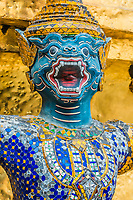 yaksha demon supporting golden chedi grand palace Bangkok Thailand