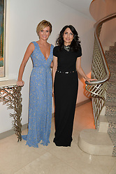 Left to right, AMANDA HOLDEN and RENU MEHTA at the Fortune Forum Club dinner in the presence of HSH Prince Albert II of Monaco held at The Dorchester, Park Lane, London on 15th January 2014.