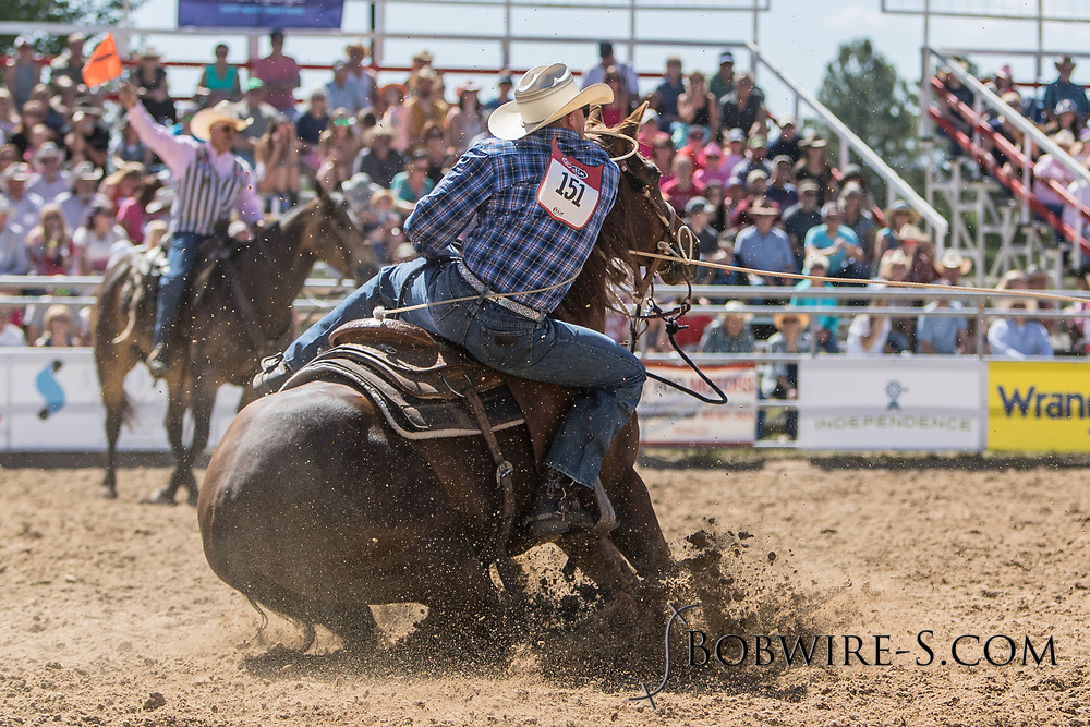 Tie-down roper Kade Kinghorn makes his run in the first performance of the Elizabeth Stampede on Saturday, June 2, 2018.