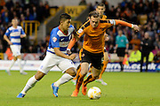 Richard Stearman tries to stop Massimo Luongo during the Sky Bet Championship match between Wolverhampton Wanderers and Queens Park Rangers at Molineux, Wolverhampton, England on 19 August 2015. Photo by Alan Franklin.
