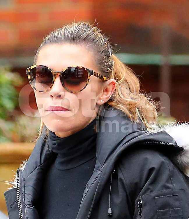 Model Abbey Clancy wearing a fur hooded jacket, cropped polo-neck top, black leggings and trainers on her way to Strictly Come Dancing rehearsals in London, UK. 17/12/2013<br />