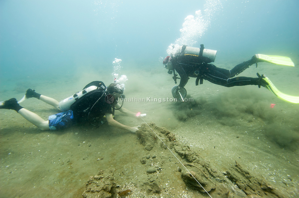 Archaeologists Christopher Horrell and Vicente Cortez prepare to take a baseline measurement of the Encarnación, a 17th century shipwreck discovered during an expedition looking for Henry Morgan's lost fleet of 1671 in Panama.