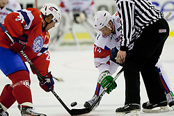 Matej Hocevar of Slovenia vs Morten Ask of Norway during ice-hockey match between Slovenia and Norway in Slovenia Euro ice hockey challenge, on December 15, 2011 at Hala Tivoli, Ljubljana, Slovenia. Slovenia defeated Norway 4:1. (Photo By Matic Klansek Velej / Sportida)