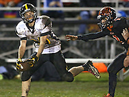 Midland's Seth Groth (85) pulls in a pass as Springville's Brian Allsup (1) can't keep up during their game at Allison Field in Springville on Friday October 19, 2012. Midland defeated Springville 30-29.
