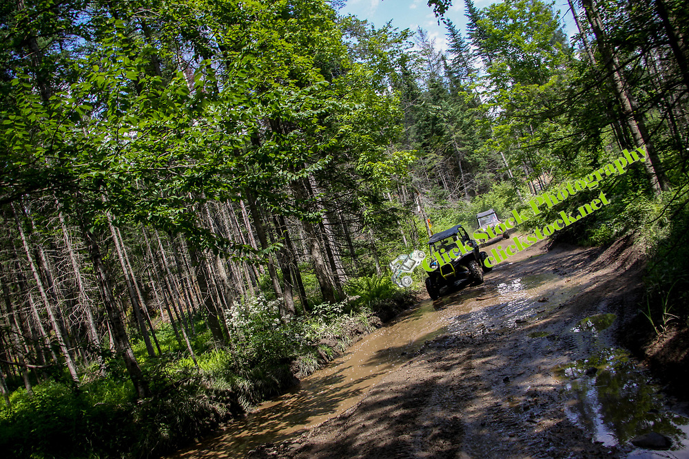 Two Rzr's on wet & muddy trail, NH, New Hampshire, New England, muddy, wet, Rzr, Polaris, atv, utv, sxs, ohrv, orv, trail riding, hobby, adventure, sports, therapy, Click Stock Photography