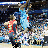 01 November 2015: Charlotte Hornets guard P.J. Hairston (19) goes for the layup past Atlanta Hawks guard Kyle Korver (26) during the Atlanta Hawks 94-92 victory over the Charlotte Hornets, at the Time Warner Cable Arena, in Charlotte, North Carolina, USA.